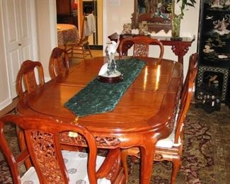 "Rosewood Dining table with 2 ext. Leaves Dimension: W42"" x D80"" x H30"" 2 -Rosewood dining arm chair 6-Rosewood Dining Side Chair Purchased in Hong Kong in 1992 at Far Eastern Furnishing LTD. Hand carved table and chair set"