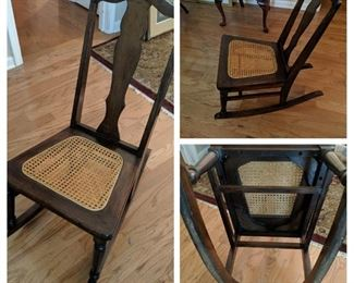 Antique rocking chair with woven seat