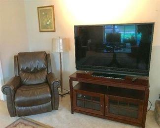 Flatscreen tv, tv cabinet, recliner