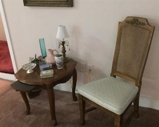 One of a pair cane backed side chairs plus nice side table