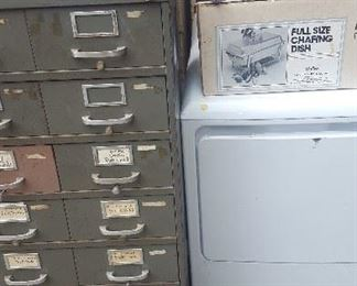 like new electric dryer, storage cabinets