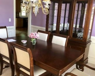 Lovely upholstered contemporary dining room ensemble seats six comfortably.
