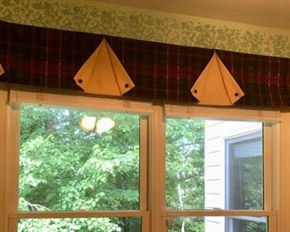 Custom window treatments throughout the house are all for sale.
