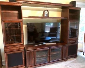 Great entertainment/storage center with room for recordings and game console.  Polk speakers & a subwoofer.
