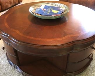 Unique coffee table with storage drawers.