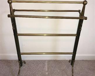 Brass quilt rack.
