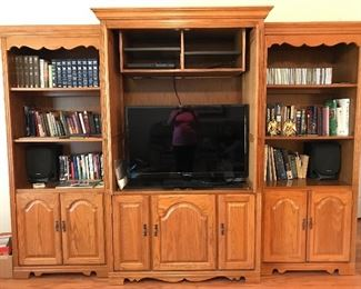 Large solid oak 3-piece entertainment wall unit—bookcase cabinets on each side and TV/component cabinet in the middle. Buy one, two or three pieces.