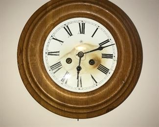 Antique clock with key.