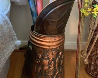 #57Brass/Copper Pitcher w/people Design on Front $30.00