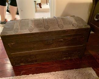 #25small antique camel back trunk with tray  $75.00
