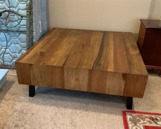 #27wood teck 4x4 custom made coffee table with storage under it on metal legs  $350.00