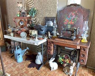 Vintage Singer pedestal sewing machine with cabinet