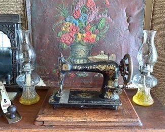 Vintage Singer sewing machine with cabinet. Pair of oil Hurricane lamps