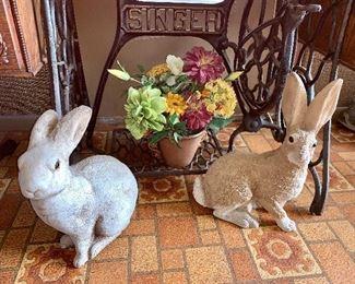 Two adorable concrete rabbits