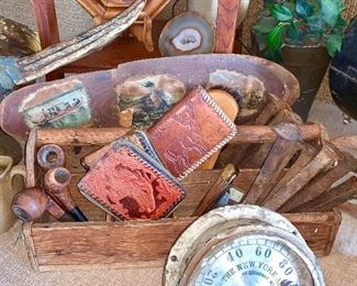 Vintage toolbox with smoking pipes, leather tooled wallets,  iron railroad spikes and more