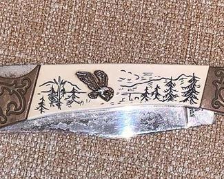 Engraved pocket knife with eagle