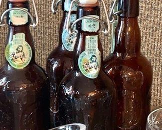 Four vintage beer bottles