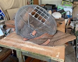 Vintage Baseball catchers mask- love to see this hanging out of doors with plant in it