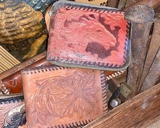 close up of leather tooled wallets
