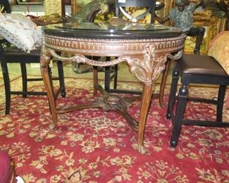 ROUND CARVED TABLE WITH BLACK MARBLE TOP