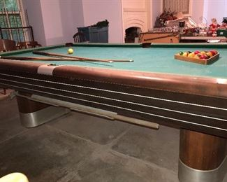 "I quote a Minnesota pool table dealer here about the Brunswick Anniversary model pool table. (""Hottest selling vintage pool table in America. I have been selling this model faster than I can get them restored and this photo display is just a few of those that I have sold in the past year or so. Made in 1945 and improved over the next several years until the late 50's. The Anniversary table is highly sought after by designers because of the mid century modern appeal of the ART DECO features it possesses."")"