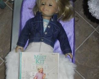 American Girl doll, bed, fur throw and book