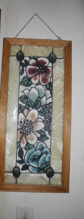 Lovely stained glass piece to hang in the window or on the wall