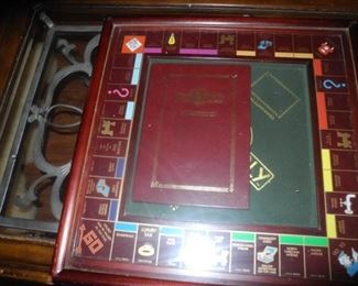 Hard to find Monopoly game in wooden case and drawers for the pieces, nice!