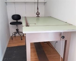 5' x 3' steel adjustable drafting table with drawers, parallel rule, adjustable lamp and adjustable stool on casters