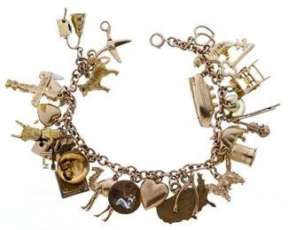 14k Gold and 10k Gold Charms on 14k Gold Bracelet