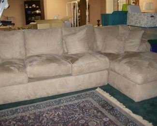 Large sectional sofa  one arm section,  one  chaise  section, plus  3 more   Also shown is a 5 x 8 area rug.
