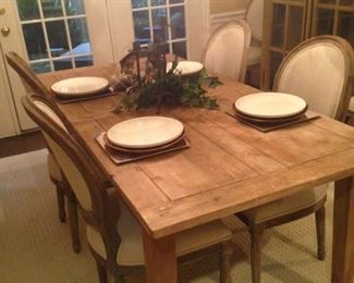 This handsome table (from Restoration Hardware) was made from recycled wood and has 8 matching chairs.