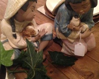 Lladro figurines of Vietnam children