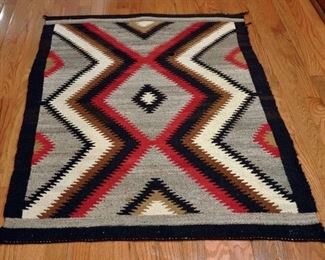 "Eye Dazzler - 1930s-1950s, 33' by 50.5""; double border; black border breaks at end; homespun warp, mahogany dye; some damage"