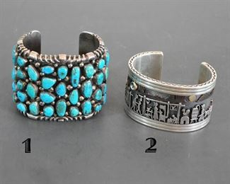 2 fantastic cuff bracelets - one on the right is a Clarence Lee Storyteller bracelet