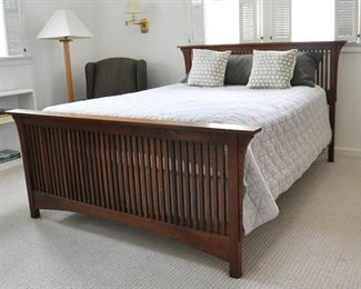 Stickley Furniture queen size bed in cherry, foundations sold separately.