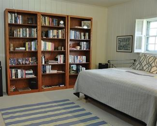 Oak bookcase unit - there is a 6' by 8' Pottery Barn Dhurrie on the floor.