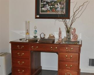 Very nice solid wood desk that is finished on all sides and has a glass protected top.