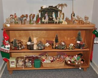 Apartment - Solid wood low bookshelf with antique nativity (mostly German pieces); also small German and Japanese buildings, trees and cast iron figures