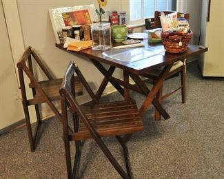 Apartment has a nice little drop leaf table and also a set of wood folding chairs.  See more apartment photos on our website.