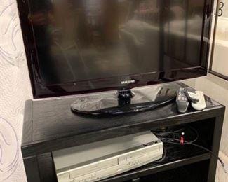 Samsung TV, VHS DVD player and TV stand https://ctbids.com/#!/description/share/153849
