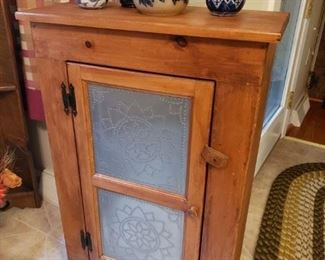 Small cabinet with punched tins