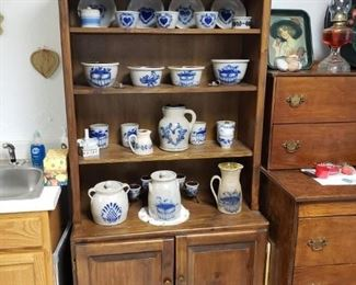 Pine  cabinet with reproduction salt glazed pottery