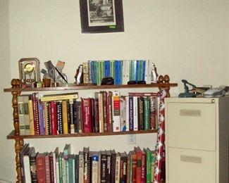 Frank Dill signed artwork.  Books, bookshelf & filing cabinet.