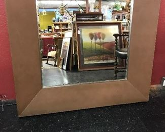 "49""X 48""beveled mirror with leather frame."