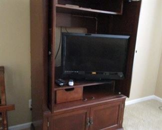 Traditional Entertainment Center Cabinet.. for TV., Could be used for books, wet bar or Bedroom Stg. Cabinet... Beautiful Walnut Wood... Excellent Condition.