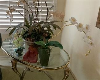 Glass table and decor. Plants. Orchid.