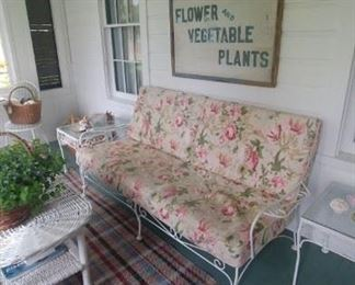 Iron porch settle, floral cuchions with cording