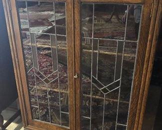 English oak leaded glass bookcase