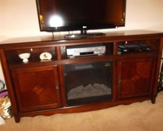 TV cabinet with electric fireplace heatolator